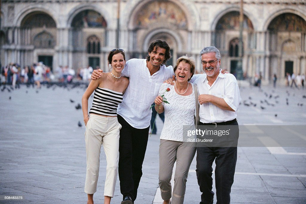 Couples walking together in St. Mark's Square, Venice, Veneto, Italy