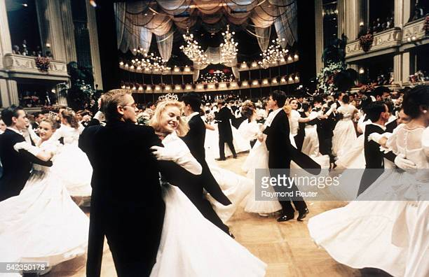 Couples waltz during the Vienna Opera Ball an annual event held at the Vienna State Opera in Vienna Austria