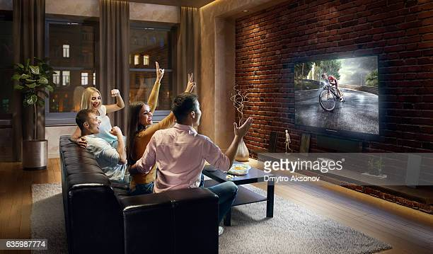 Couples watching Bicycle race at home