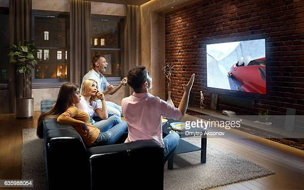 Couples watching bobsleigh game at home