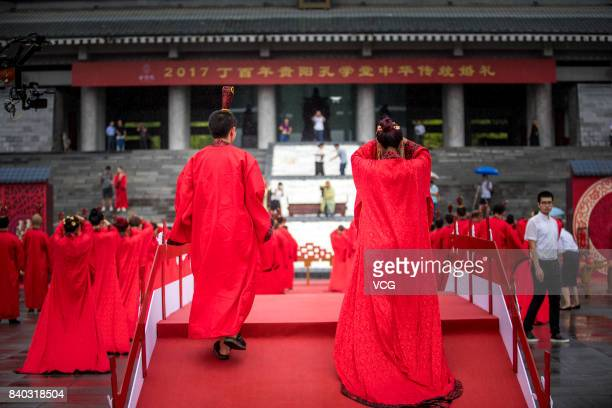 30 couples wearing Han Chinese clothes attend a group wedding ceremony to greet the Chinese Valentine's Day at Confucian Academy on August 28 2017 in...