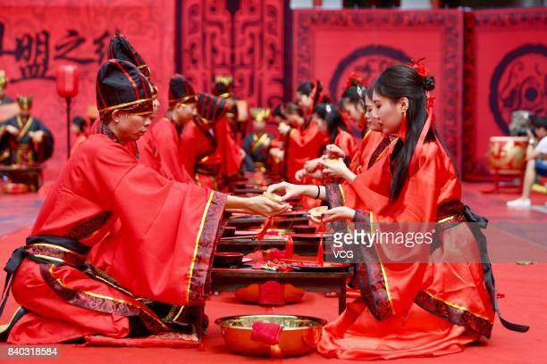 19 couples wearing Han Chinese clothes attend a group wedding ceremony to greet the Chinese Valentine's Day at Heng Mountain on August 28 2017 in...