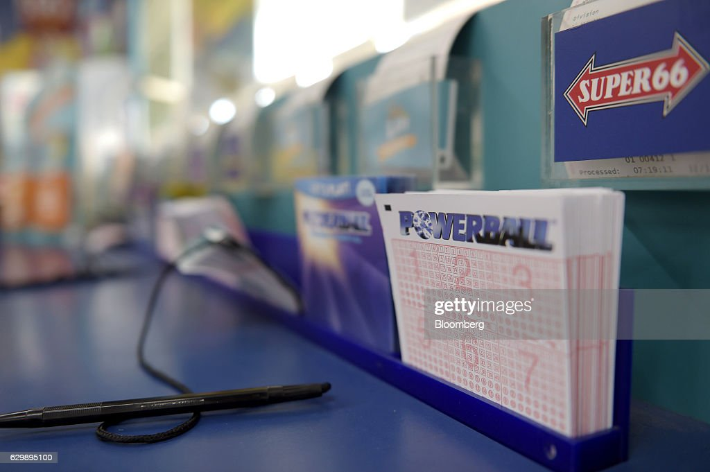 Coupons for Tatts Group Ltd.'s Powerball lottery game sit at a counter at a newsagent's store in Melbourne, Australia, on Thursday, Dec. 15, 2016. A consortium including Morgan Stanley and KKR & Co. offered as much as A$7.3 billion ($5.5 billion) for Australian betting and lotteries business Tatts Group, setting up a potential bidding war with Tabcorp Holdings Ltd. Photographer: Carla Gottgens/Bloomberg via Getty Images