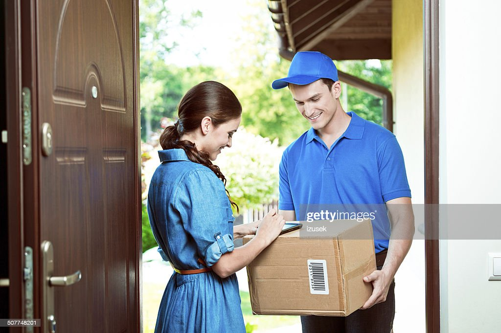 Courier delivering package : Stock Photo