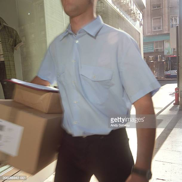 Courier delivering packages, mid section