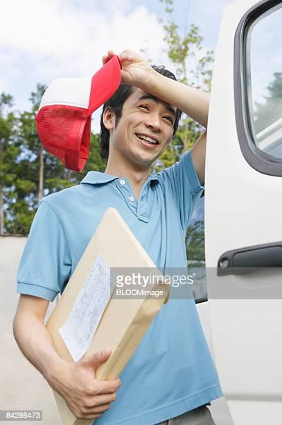 Courier delivering parcel