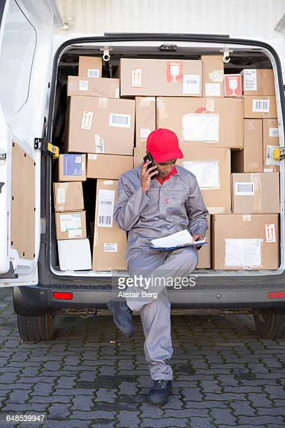 Courier delivering parcels and boxes