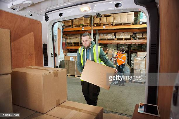 courier filling his van
