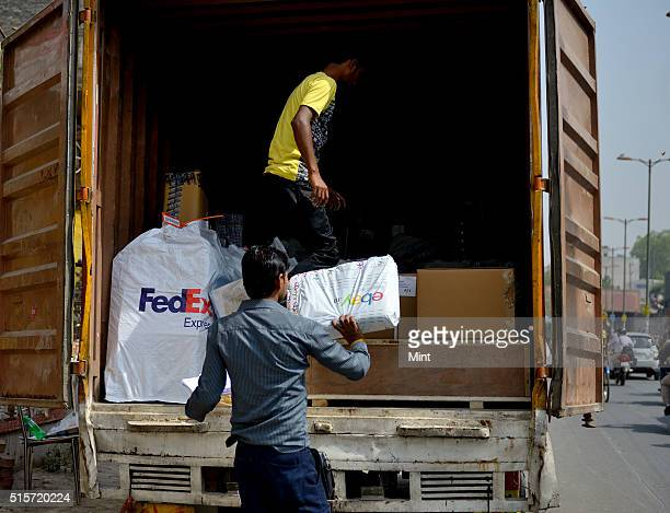 Courier service Fedex employees handling the products of various ecommerce companies at a courier station to deliver them at doorsteps of customers...