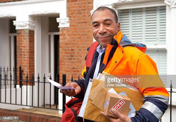 Courier/postman delivering mail