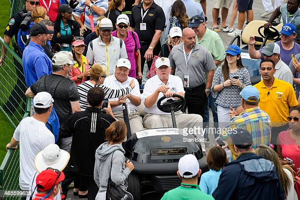 Course owner Donald Trump drives a golf cart during the final round of the World Golf ChampionshipsCadillac Championship at Blue Monster Trump...