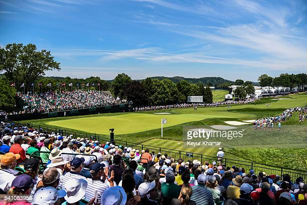 A course scenic view as fans watch play on the 18th hole green during the continuation of the second round of the US Open at Oakmont Country Club on...