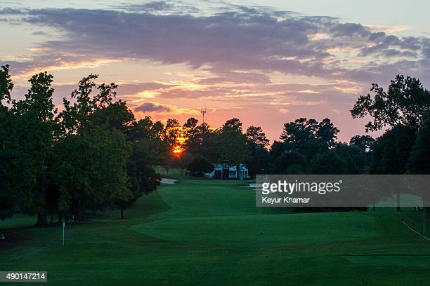 A course scenic view as the sun sets behind the the first hole during practice for the TOUR Championship by CocaCola the final event of the PGA TOUR...