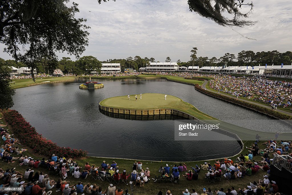 A course scenic view of fans watching Justin Rose of England and Sergio Garcia of Spain on the 17th hole island green during the third round of THE PLAYERS Championship on THE PLAYERS Stadium Course at TPC Sawgrass on May 10, 2014 in Ponte Vedra Beach, Florida.