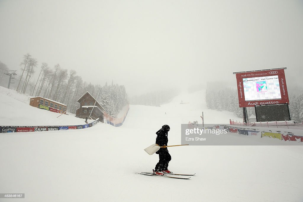 A course worker skis past the finish line of the Birds of Prey FIS Ski World Cup course on December 4, 2013 in Beaver Creek, Colorado. Downhill training was cancelled for excessive snow.