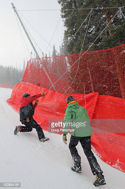 Course workers prepare the A Netting on the downhill course at the US Ski Team Speed Center at Copper on November 15 2011 in Copper Mountain Colorado...