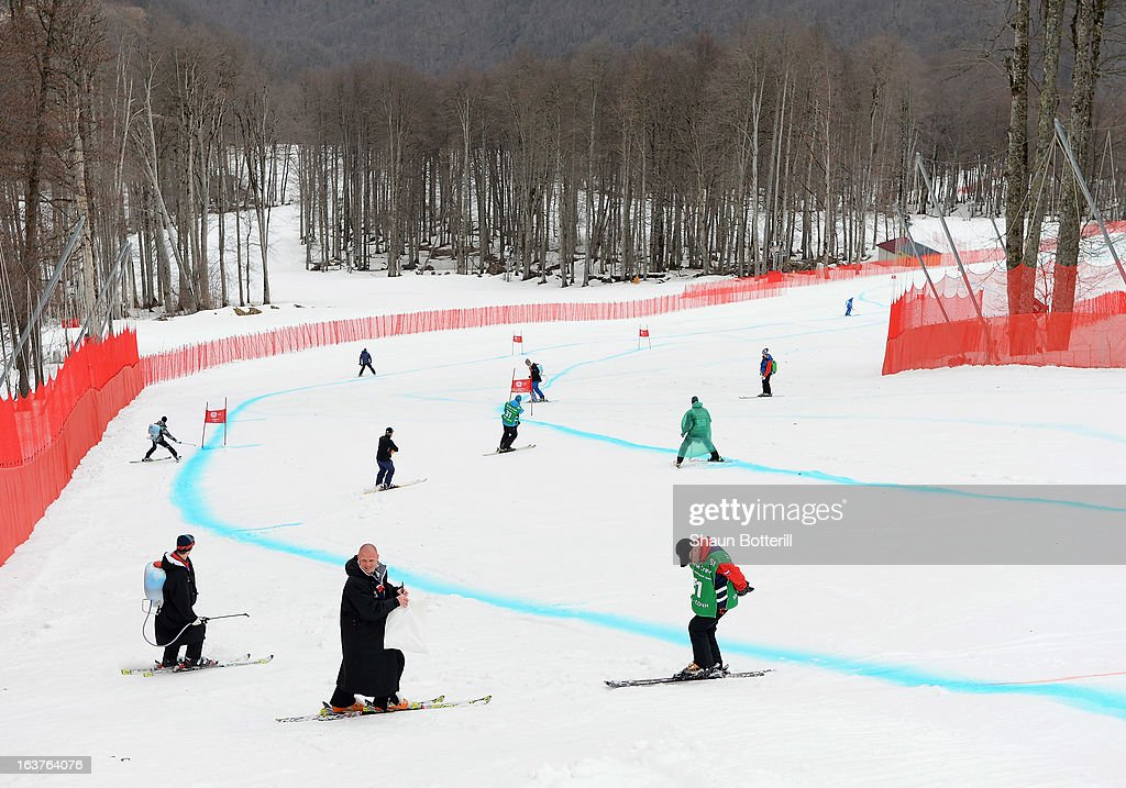 Course workers prepare the course for the cancelled Ladies' Downhill Training at Rosa Khutor Alpine Center on March 15, 2013 in Sochi, Russia.