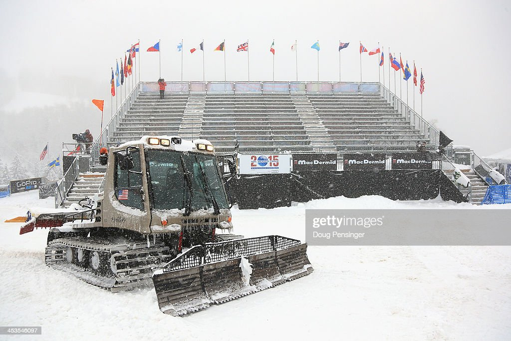 Course workers use a snow cat to remove snow in the base area as downhill training for the Birds of Prey Audi FIS Ski World Cup was cancelled due to excessive snow on December 4, 2013 in Beaver Creek, Colorado.