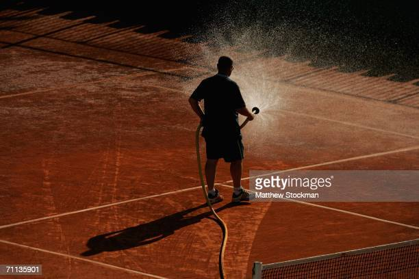 Court attendants groom the playing surface after day ten of the French Open at Roland Garros on June 6 2006 in Paris France