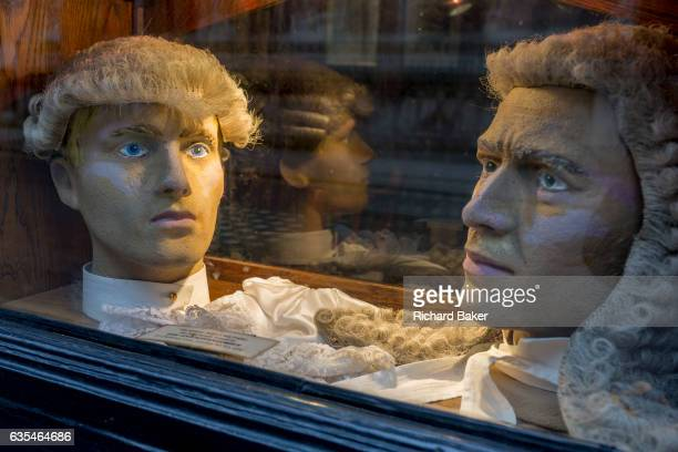Court dress wigs for the legal profession donated by outfitters Ede Ravenscroft in the window of the Seven Stars pub opposite the Royal Courts of...