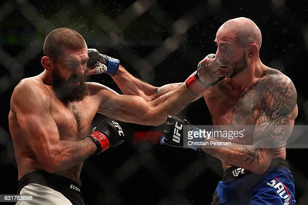 Court McGee and Ben Saunders exchange punches during the UFC Fight Night event at the at Talking Stick Resort Arena on January 15 2017 in Phoenix...