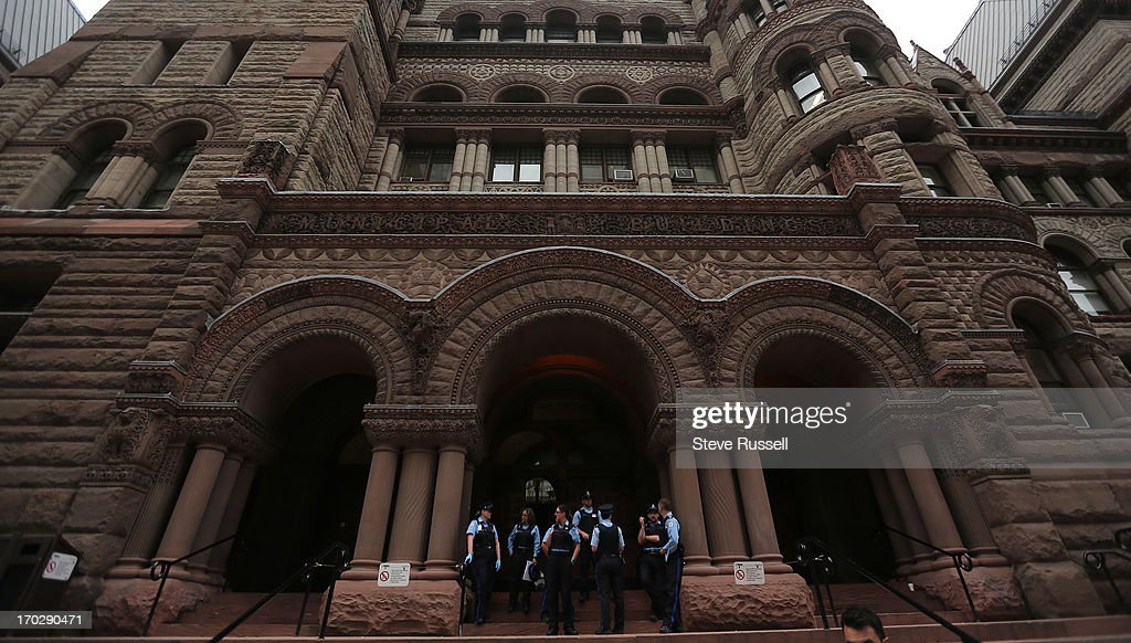 Court officers move prisoners and lock entrances to Old City Hall after the building was evacuated after a fire in one of the washrooms at Old City Hall.