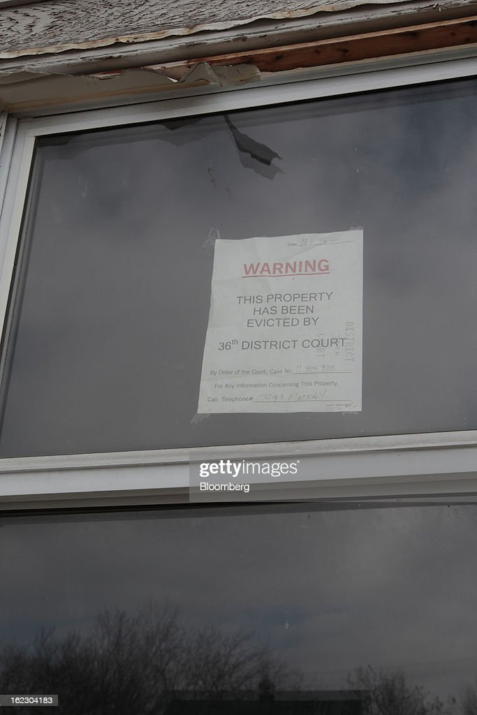 A court ordered eviction notice is taped in the window of a house on Mackay Street in Detroit, Michigan, U.S., on Thursday, Feb. 21, 2013. A fiscal emergency grips Detroit, according to a report ordered by Governor Rick Snyder, that opens a path to a state takeover of General Motors Co.'s home town, citing deficits that have stymied city officials after a $326.6 million gap last year. Photographer: Jeff Kowalsky/Bloomberg via Getty Images