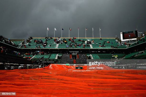 Court Philippe Chatrier is covered due to rain on day ten of the 2017 French Open at Roland Garros on June 6 2017 in Paris France