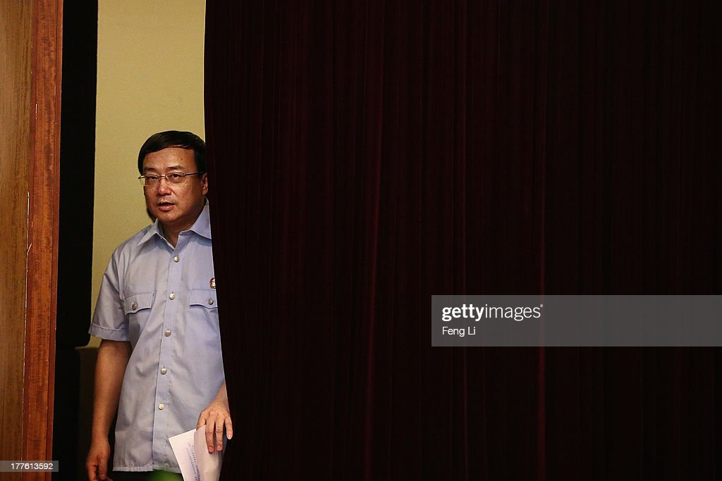 Court spokesman Liu Yanjie arrives at the conference room after the fourth day of the trial of disgraced politician Bo Xilai at Jinan Intermediate People's Court on August 25, 2013 in Jinan, China. Ousted Chinese politician Bo Xilai is standing trial on charges of bribery, corruption and abuse of power for a third day. Bo Xilai made global headlines last year when his wife Gu Kailai was charged and convicted of murdering British businessman Neil Heywood.