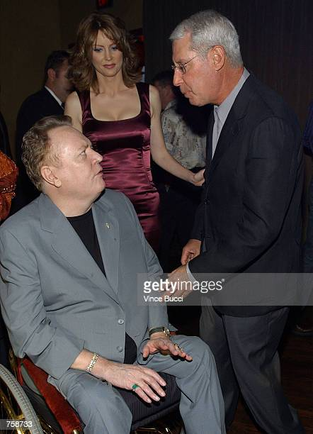 Court TV president Henry Schlief and show host Wendy Walsh talk with publisher Larry Flynnt at celebration of the oneyear anniversary of the cable...