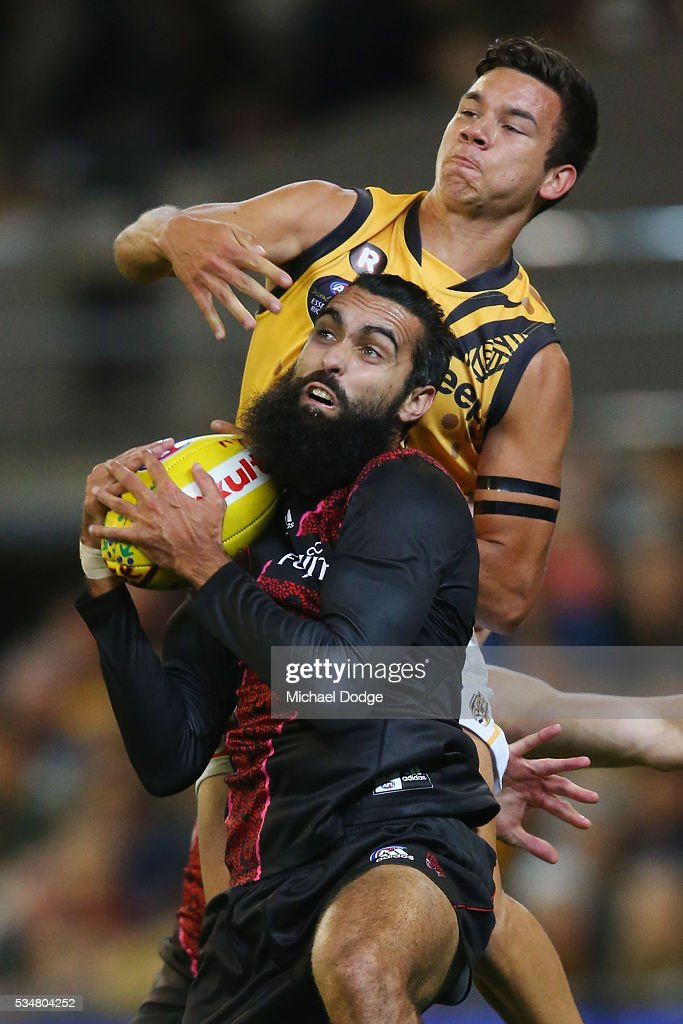 Courtenay Dempsey of the Bombers marks the ball against Daniel Rioli of the Tigers during the round 10 AFL match between the Essendon Bombers and the Richmond Tigers at Melbourne Cricket Ground on May 28, 2016 in Melbourne, Australia.