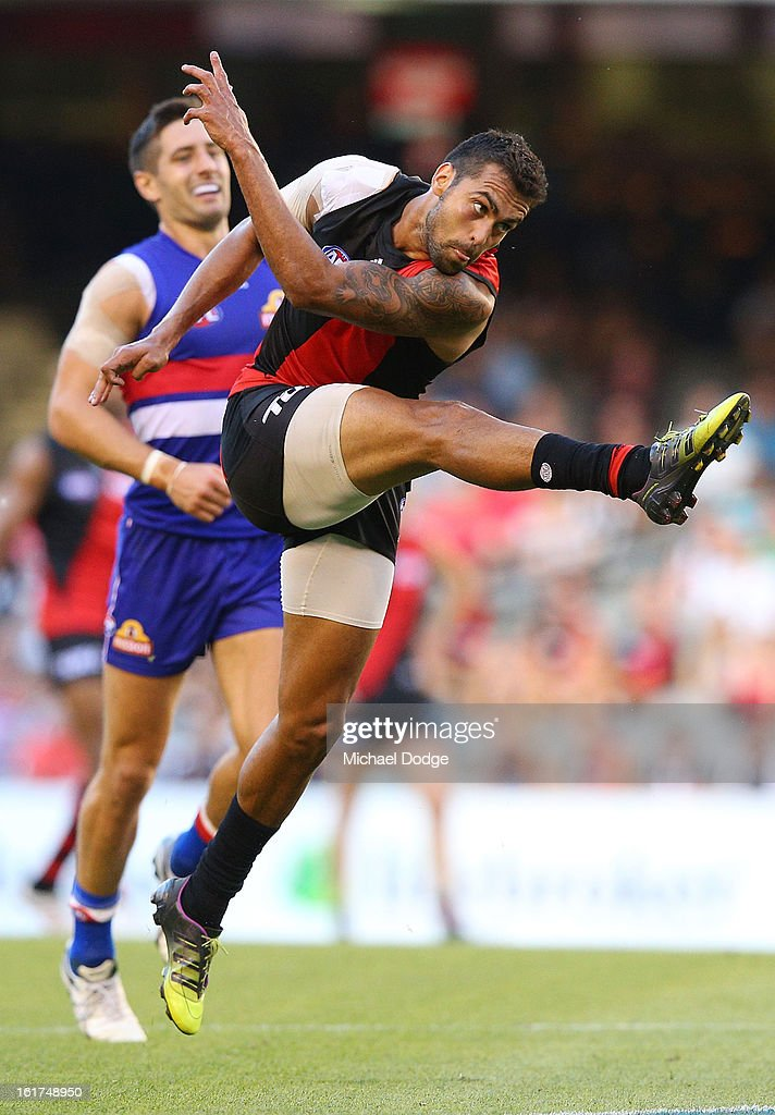 Courtenay Dempsey of the Essendon Bombers kicks the ball during the round one AFL NAB Cup match between the Essendon Bombers and the Western Bulldogs at Etihad Stadium on February 15, 2013 in Melbourne, Australia.