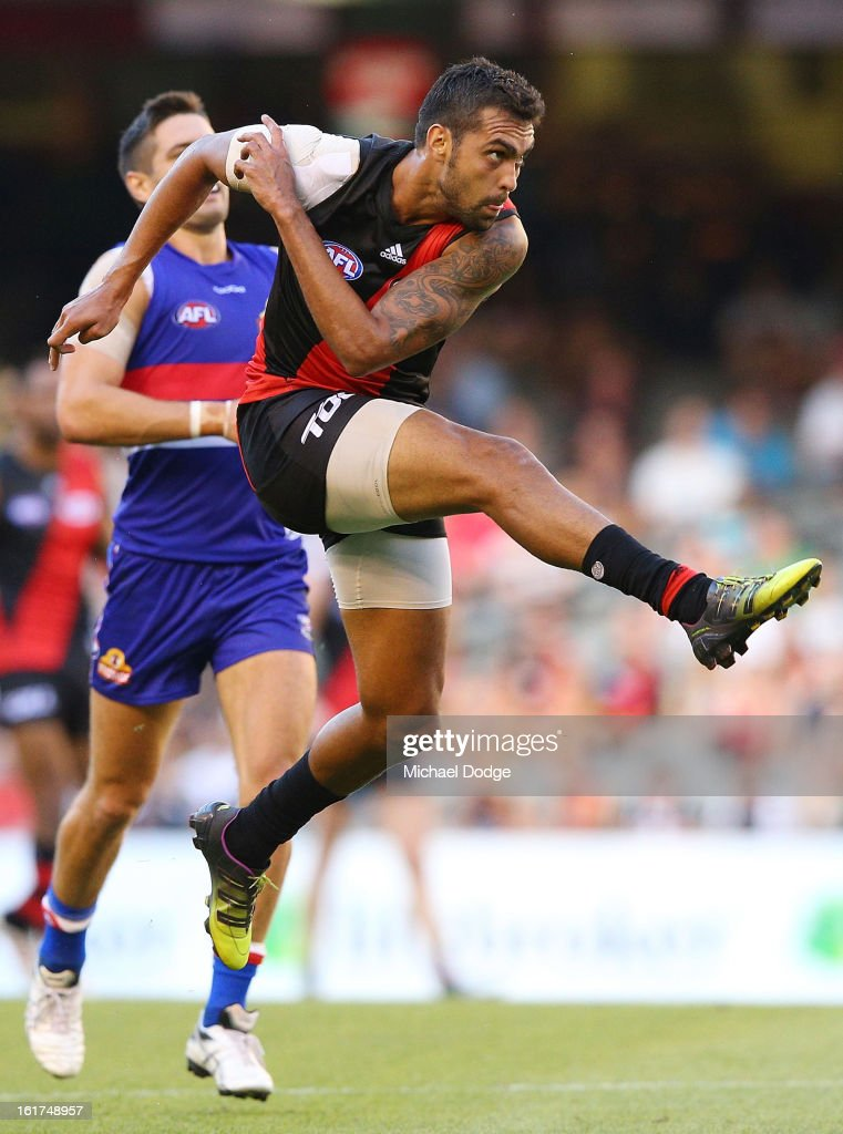 Courtenay Dempsey of the Essendon Bombers kicks with the ball during the round one AFL NAB Cup match between the Essendon Bombers and the Western Bulldogs at Etihad Stadium on February 15, 2013 in Melbourne, Australia.