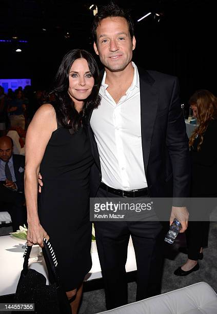 Courteney Cox and Josh Hopkins attend the TNT/ TBS Upfront 2012 at Hammerstein Ballroom on May 16 2012 in New York City 22362_001_0019JPG