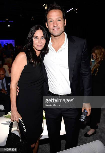 Courteney Cox and Josh Hopkins attend the TNT/ TBS Upfront 2012 at Hammerstein Ballroom on May 16 2012 in New York City 22362_001_0020JPG