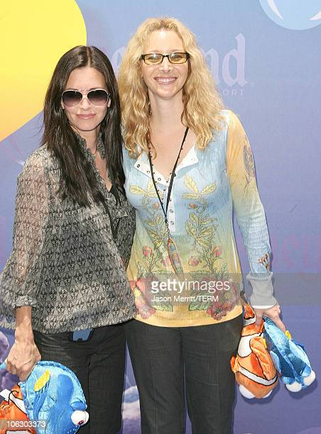 Courteney Cox and Lisa Kudrow during Finding Nemo Submarine Voyage Opening Arrivals at Disneyland in Anaheim California United States