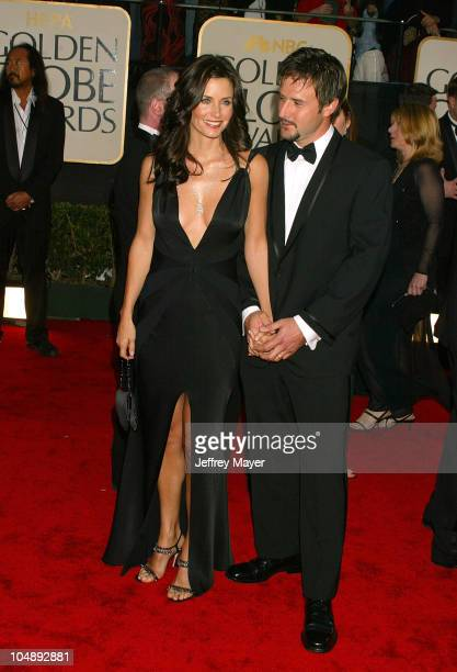 Courteney Cox Arquette and David Arquette during The 60th Annual Golden Globe Awards Arrivals at The Beverly Hilton Hotel in Beverly Hills California...