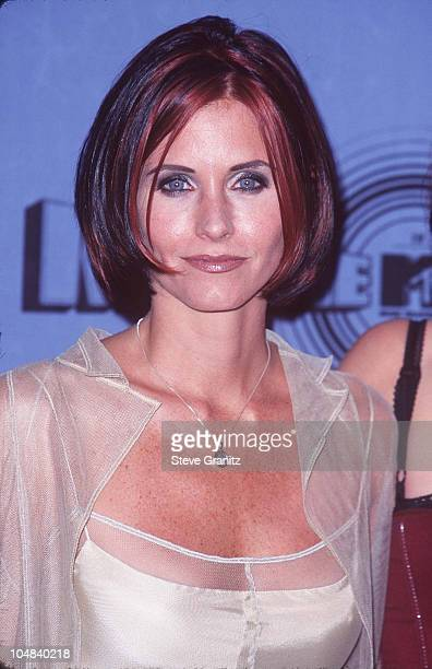 Courteney Cox during The 1997 MTV Movie Awards at Barker Hanger in Santa Monica California United States