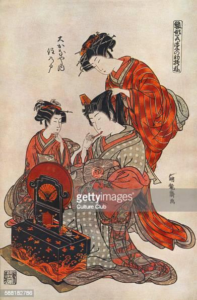 Courtesan in kimono being groomed by her hand maiden Print by Isoda Koriusai Japanese printmaker in the ukiyoe style IK 17351790 Traditional Kimonos