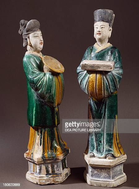 Courtesans carrying a plate and a little box glazed terracotta statues height 43 cm and 45 cm China Chinese Civilisation Ming dynasty 17th century