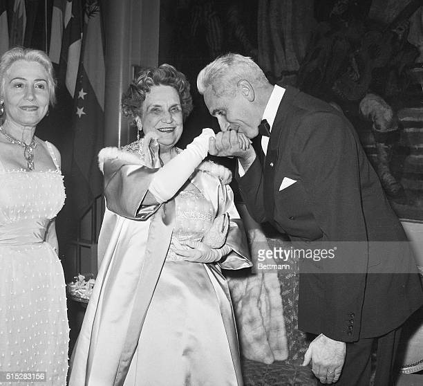 Courtesy Kiss New York Essaying a gentlemanly gesture French Ambassador Armand Berard kisses the hand of Perle Mesta during the United States Ball at...