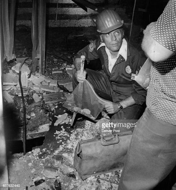 S Courthouse takes abuse from Dynamite blast Investigators above sifted through the wreckage at the Champa Street entrance of the federal courthouse...