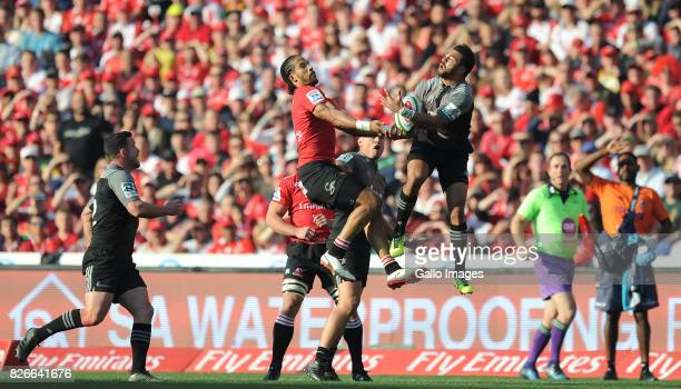 Courtnall Skosan of Lions is tackled by Richie Mounga of Crusaders during the Super Rugby Final match between Emirates Lions and Crusaders at...