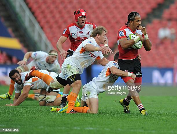 Courtnall Skosan of Lions is tackled by Torsten van Jaarsveld and William SmallSmith of Cheetahs during the Super Rugby match between Emirates Lions...