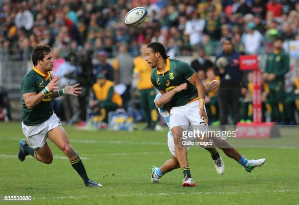 Courtnall Skosan of South Africa gets the ball to Jan Serfontein during the Rugby Championship match between South Africa and Argentina at Nelson...