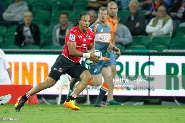 Courtnall Skosan of the Lions runs the ball down the wing during the round 10 Super Rugby match between the Force and the Lions at nib Stadium on...