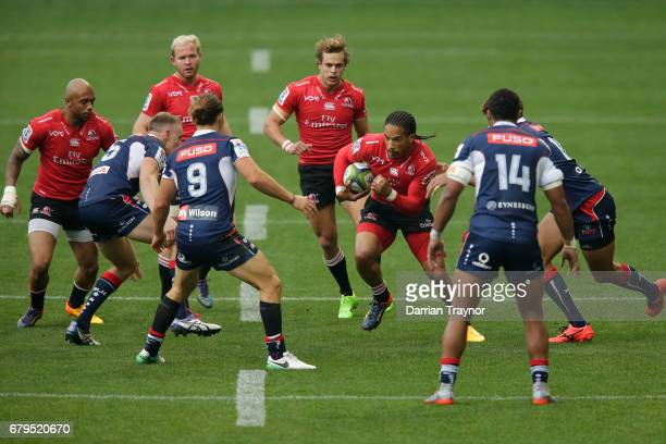 Courtnall Skosan of the Lions takes on the defence during the round 11 Super Rugby match between the Rebels and the Lions at AAMI Park on May 6 2017...