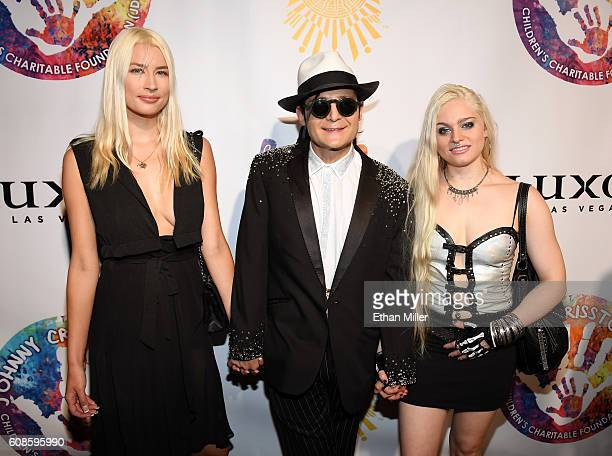Courtney Anne actor Corey Feldman and Brittany Paige attend Criss Angel's HELP charity event at the Luxor Hotel and Casino benefiting pediatric...