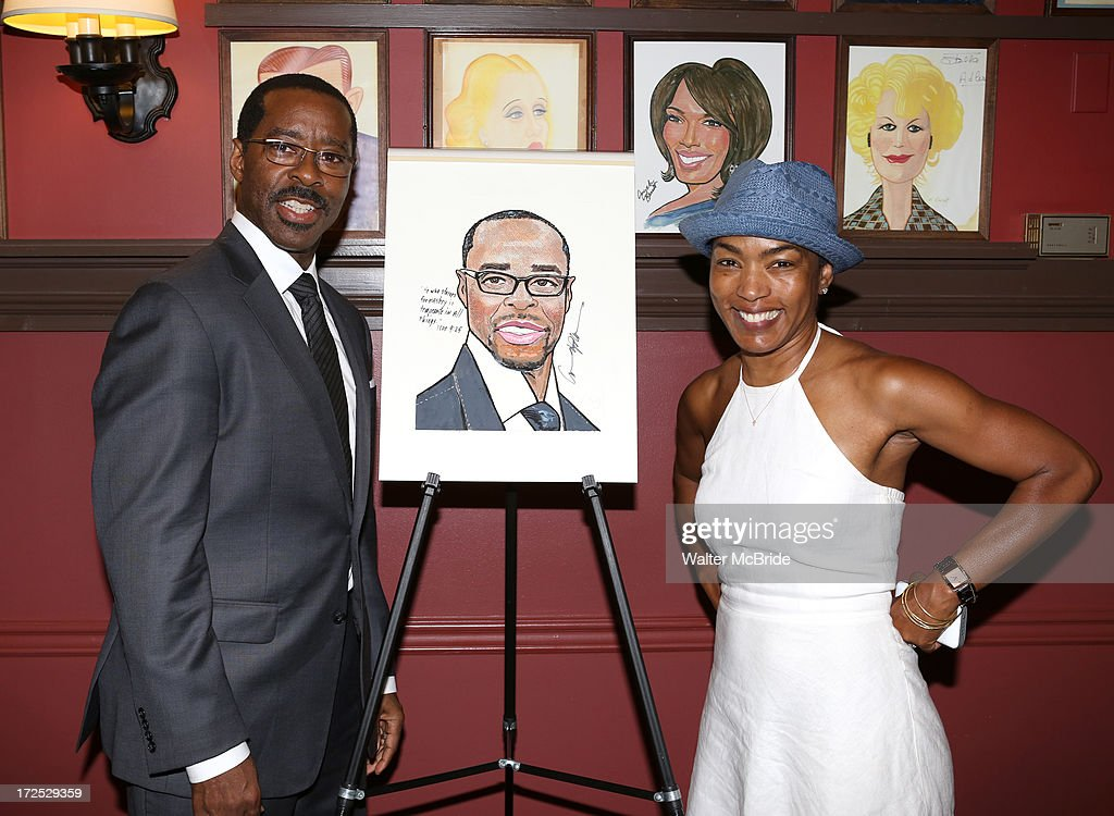 Courtney B. Vance and wife Angela Bassett attend Courtney B. Vance's Caricature Unveiling at Sardi's on July 2, 2013 in New York City.