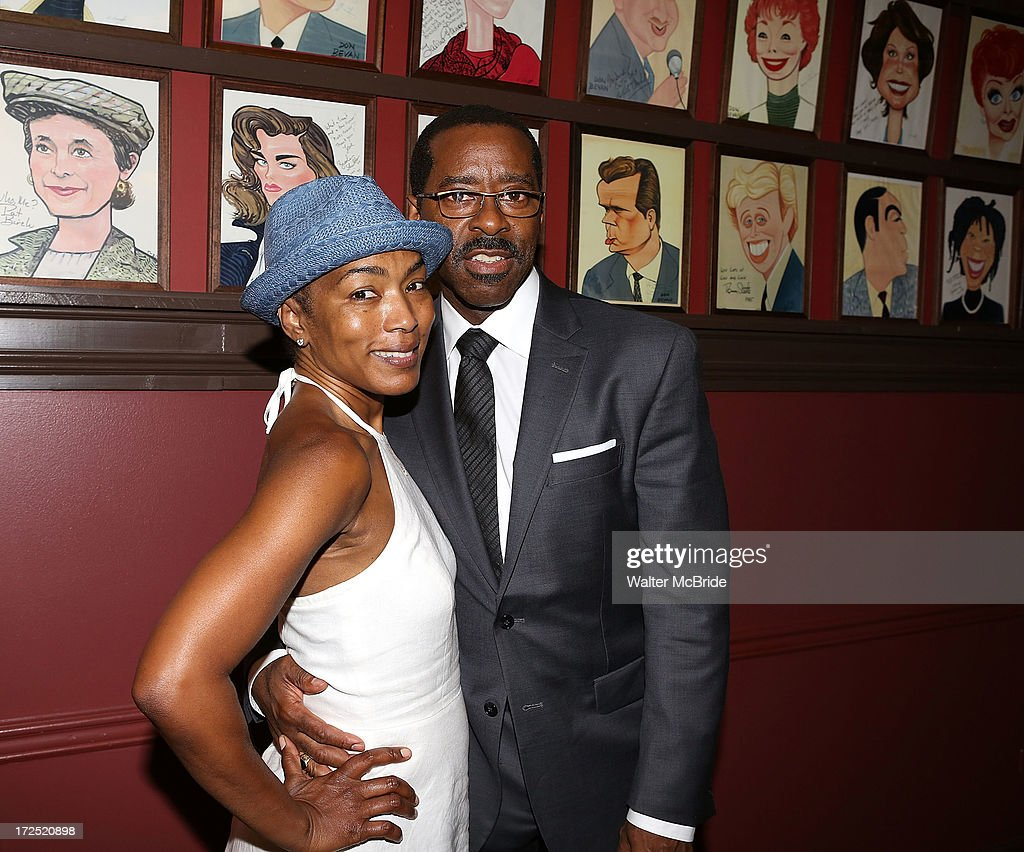 Courtney B. Vance' and wife Angela Bassett attend Vance's caricature unveiling at Sardi's on July 2, 2013 in New York City.